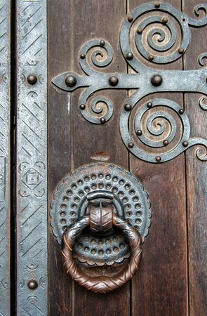 Detail of an old ornate wooden door
