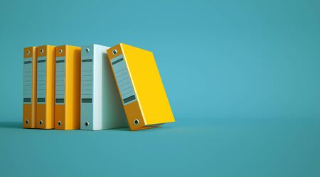 3D rendering of yellow and gray ring binders on a blue background Imagens