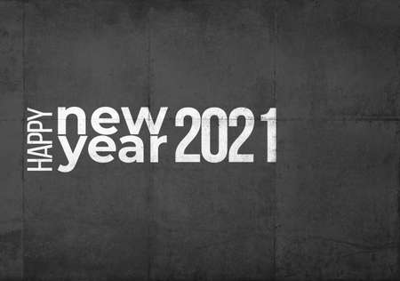 Happy New Year 2021 in white letters on a gray grunge industrial background