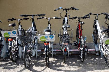 Bikes parked in Geneva city, sunny day Editorial