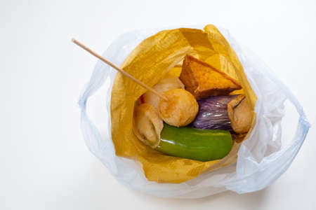 Some Hong Kong street deep-fried snack in a take-away plastic bag