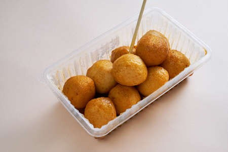 A plastic box of Hong Kong-style curry fish balls