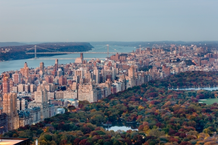 Autumn in New York  Aerial photography of Central Park and its colorful trees in fall, and UWS, Manhattan - George Washington Bridge spans Hudson River in the background Cityscape photography