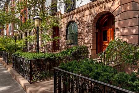 chelsea: Row of townhouses and their lovely front yards and lampposts  Afternoon light in Chelsea, Manhattan, New York