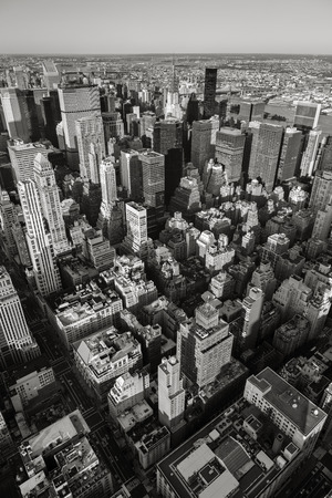 manhattans: Aerial view of New York cityscape from Manhattans Midtown East and Upper East Side to Queens in the background. Black & White Vertical New York. Urban view of NY buildings, high-rises and skyscrapers seen from above.