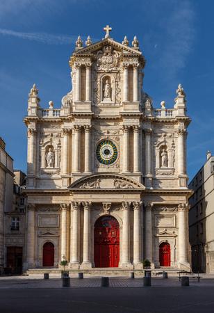 enhances: Facade of the church of Saint-Paul-Saint-Louis in the Marais neighborhood (4th arrondissement) of Paris, France. The morning lights enhances the facade Stock Photo