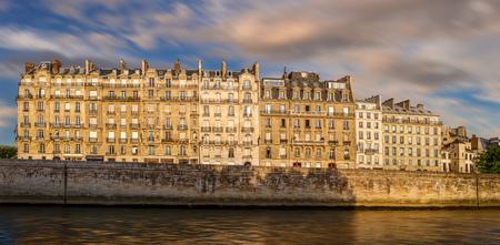 cite: Early morning light on the Seine river banks and Ile de la Cite in Paris, France (4th arrondissement)