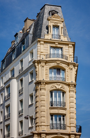 faux: Belle epoque style building in the 12th arrondissement, Paris, France with faux balconies, wrought iron railings and slate Mansard roof. Built in 1900.