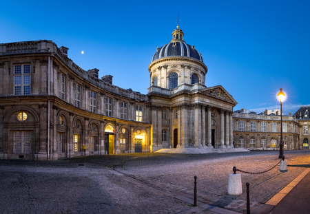 academie: The French Institute (Institut de France) , in Paris, France. Its famous 156 foot dome glows in the early morning light along with a setting moon.The institute is the home the French Academy and was created by architect Louis Le Vau in the Baroque Style
