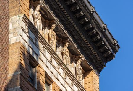 cornice: Caryatids and cornice 19th century brick building New York