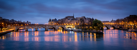 ile de la cite: Dawn on a cloudy morning in Paris France with Ile de la Cite and Pont Neuf. The Seine River reflects the violet sky and city lights. Stock Photo