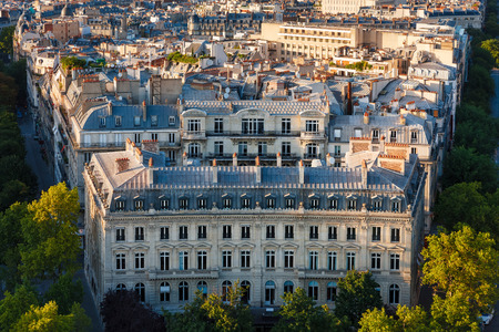 17th: Aerial photo of architectural detail of haussmanian building with curvilinear facade. Paris rooftops at the junction of the 8th and 17th arrondissement on the Right Bank Ile de France. Stock Photo