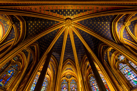 cite: Rayonnant Gothic vaulted ceiling of lower chapel of Sainte Chapelle, Ile de la Cite, Paris, France. Gilded ribs of the vault separate areas of royal blue ceiling decorated with gold fleur de lys