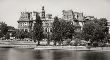 right bank: Black  White vintage look view of the south facade of Paris City Hall from the River Seine. The Renaissance Revival style edifice is on the Right Bank in the 4th arrondissement, Paris, France