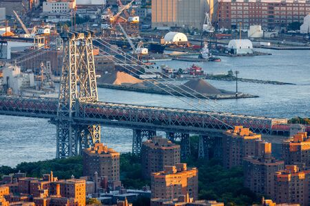lower east side: Aerial view of the Williamsburg Bridge crossing the East River from the Lower East Side of Manhattan to Brooklyn. New York City Stock Photo