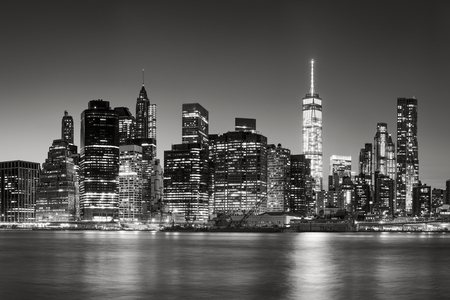 lower manhattan: Black  White East River view of Financial District skyscrapers at dusk. Lower Manhattan skyline, New York City