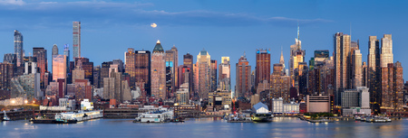 weehawken: Midtown West Manhattan skyscrapers over the Hudson River. Panoramic view in early evening with moonrise and New York City skyline