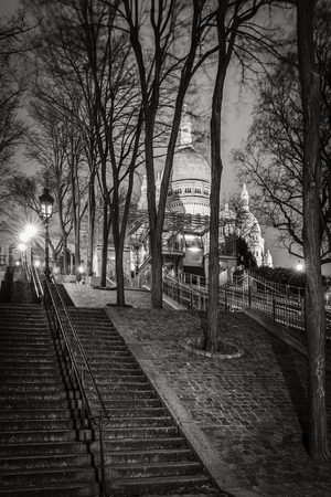 sacred heart: Stairs leading to the Basilica of the Sacred Heart Sacre Coeur Basilica at night in Montmartre - Black and White, Paris, France