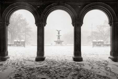 bethesda: Early morning Black  White view of the Bethesda Fountain from the Bethesda Terrace Arcade during a freezing cold winter snowstorm. Wintertime in Central Park, Manhattan, new York City