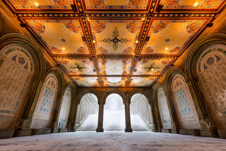 bethesda: Low angle view of the Bethesda Terrace Arcade during a winter snowstorm with illuminated tile ceiling.