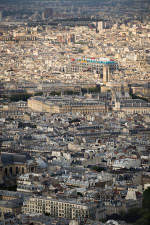ile de la cite: Aerial view, rooftops of the 4th arrondissement in Paris including Ile de la Cite, Tour Saint Jacques and Centre Georges Pompidou Pompidou Center in the Marais. France