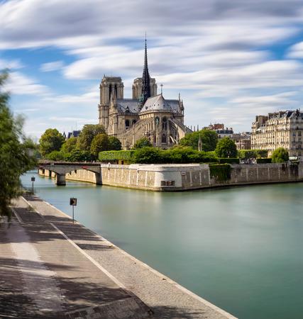 ile de la cite: Long exposure of Notre Dame Cathedral  the Seine River on Ile de La Cite, Paris, France. The Cathedral exemplifies French Gothic architecture. 4th Arrondissement, 75004 Paris