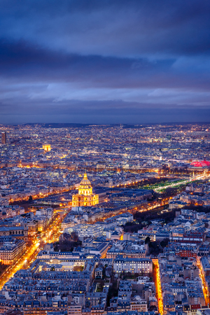 avenues: Aerial view of streets and avenues of Paris at twilight.The Invalides and Army Museum are at the center. The Arch of Triumph is in the distance. France Stock Photo