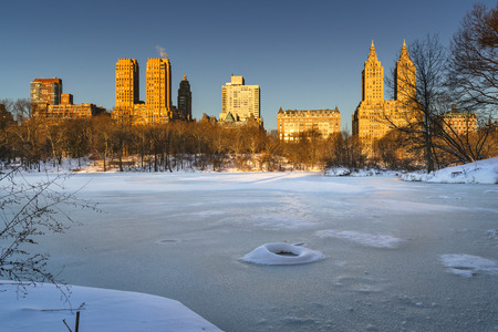 winter sunrise: Winter sunrise on frozen Central Park Lake with view of the Upper West Side buildings. Manhattan, New York City
