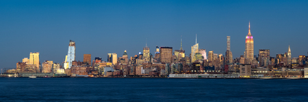 hudson river: Panoramic view at dusk of Manhattan Midtown West and illuminated skyscrapers with the Hudson River. New York City Stock Photo