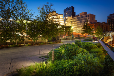 The Highline at twilight in summer. The aerial greenway also called High Line or High Line Park is an oasis in the heart of Chelsea, Manhattan, New York City.