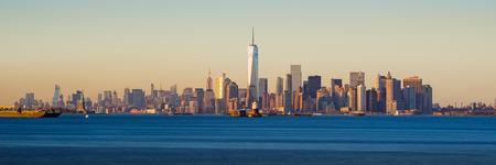 Lower Manhattan Panoramic Sunset from New York City Harbor Stock Photo