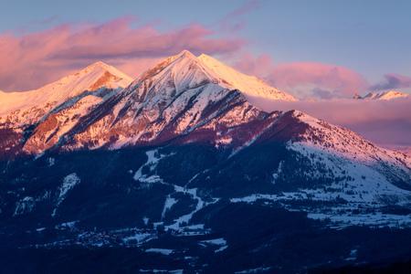 leger: Winter sunset on the Petite and Grande Autane mountain peaks. Saint Leger les Melezes, Champsaur, Hautes Alpes, Southern French Alps, France Stock Photo