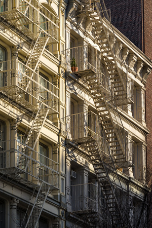 Soho building facades with fire escapes. Manhattan, New York City Stock Photo