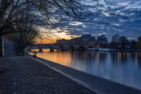 Sunrise on the Seine River banks (Quai des Tuilleries) and Ile de la Cite. 1st Arrondissement, Paris, France