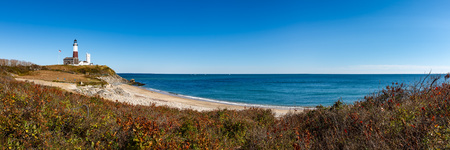 montauk: Panoramic view on Montauk Point State Park Lighthouse and the Atlantic Ocean. Long Island, New York State Stock Photo
