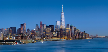 New York City Lower Manhattan at dusk. The panoramic view includes the skyscrapers of the Financial District and the Hudson River Stock Photo
