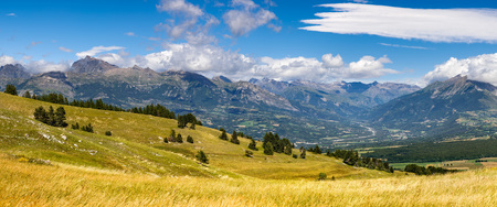 leger: Panoramic view on the Champsaur and the Drac River Valley in summer from Gleize Pass. Hautes-Alpes, Southern French Alps, Paca Region, France Stock Photo