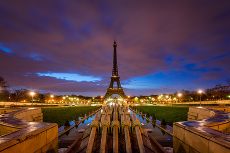 Eiffel Tower at dawn with clouds and city lights from Trocadero, Paris, France