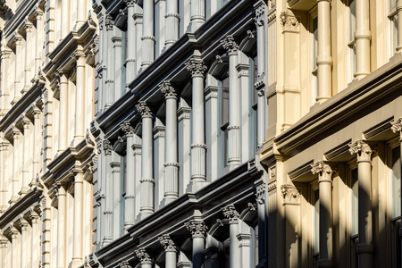 Cast iron facades and ornamentation. Nineteenth century buildings in Manhattans Soho neighborhood. New York City
