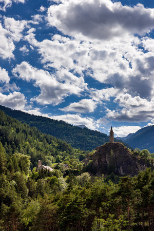 The clock tower of Meolans Revel village in the Alpes-de-Haute-Provence in summer. Ubaye Valley, PACA Region, Southern French Alps, France Stok Fotoğraf