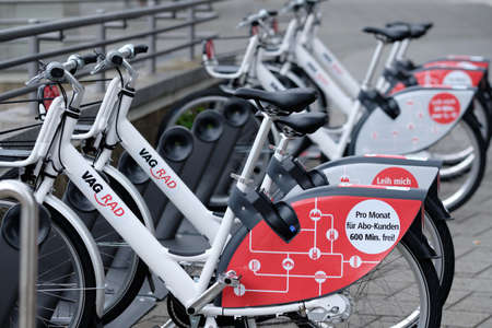 Nuremberg, Germany - August 7, 2019: White rental VAG_Rad bikes of the public transporting company VAG are standing in a row in bike stands at the Leipziger Platz