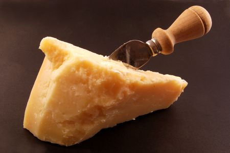 Piece of Parmesan cheese as an appetizer or for grating over pasta photo