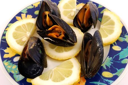 Plate of mussels with lemon photo