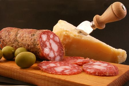 Salami with green olives and parmesan cheese photo