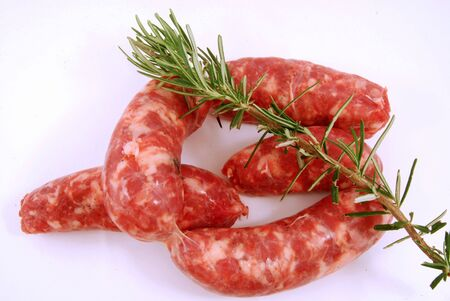 Set sausages ready to be cooked with rosemary