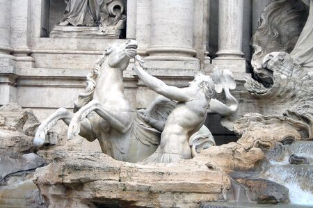 coin toss: Detail of a statue of the Trevi Fountain in Rome