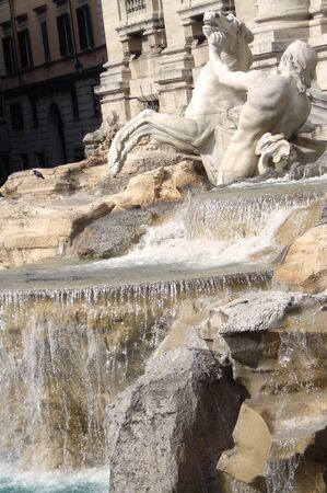 Waterfalls of the Trevi Fountain of Rome, one of the most famous fountains in the world           photo