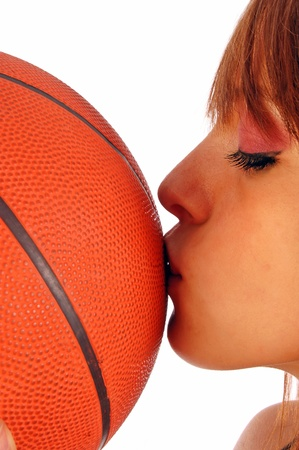 A kiss on the ball of basketball as a sign of love for sports Stock Photo