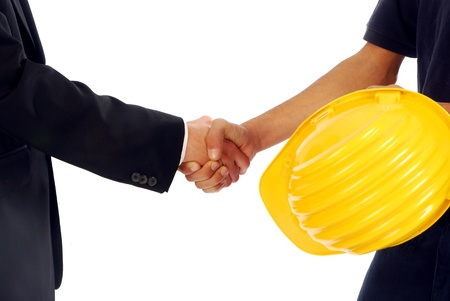 Two men greet each other shaking hands