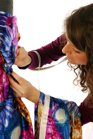 A seamstress  prepares a dress high fashion